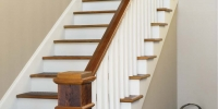 Custom stairs and pine beam newel post