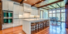 Open plan kitchen beams, wood floors, wood ceiling