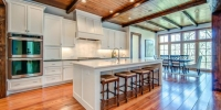 Open plan kitchen beams, wood floors, wood ceiling